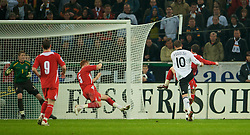 MONCHENGLADBACH, GERMANY - Wednesday, October 15, 2008: Wales' James Collins blocks a shot from Germany's Lukas Podolski during the 2010 FIFA World Cup South Africa Qualifying Group 4 match at the Borussia-Park Stadium. (Photo by David Rawcliffe/Propaganda)