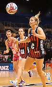 Anna Thompson gathering the ball for the Tactix during the ANZ Championship Netball game between the Mainland Tactix v Adelaide Thunderbirds at Horncastle Arena in Christchurch. 20th April 2015 Photo: Joseph Johnson/www.photosport.co.nz