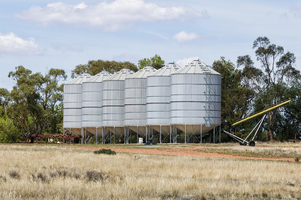 Grain silos in farm paddock in rural country New South Wales, Australia.