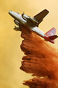 An airplane fighting the Topanga Fire drops fire retardant near Velvet Oak Court in Simi Valley on Sept. 29, 2005.