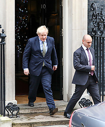 © Licensed to London News Pictures. 13/12/2019. London, UK. Prime Minister Boris Johnson leaves Downing Street to meet the Queen at Buckingham Palace to ask her permission to form a Government as the Conservative party celebrate a landslide victory in yesterday's December 12th 2019 General Election . Photo credit: Alex Lentati/LNP