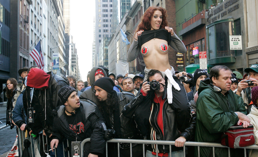 A girl flashes the crowd at a rally to celebrate Howard Stern's  final broadcast on FM radio in New Yorkspeaks to the crowd durring a rally 16 December 2005.After 21 years on the air and millions of dollars of fines from the FCC, Stern signed a $500 million 5-year deal with the largely unregulated  Sirius satellite radio which begins broadcasts