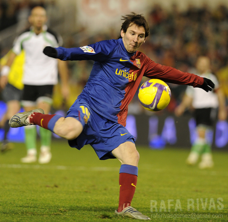 Barcelona's Argentinian Leo Messi shoots to score his second goal during a Spanish league football match against Racing Santander on February 1, 2009, at Sardinero stadium in Santander. Barcelona won 2-1. PHOTO/Rafa Rivas