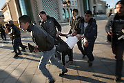 A protester injured during clash with police is carried out in a safe place by other demonstrators...On 17 december Mohamed Bouazizi a fruit seller form the city of Sidibouzid in Tunisia set fire to himself starting a wave of protest that will change several arab countries under the name of Arab Spring..Despite the dictator Zine El-Abidine Ben Ali left the country on 14 January after weeks of protest the demonstrations continue asking for the political party of the regime (RCD) and all the political men involved on the past government where banned from the political life ..