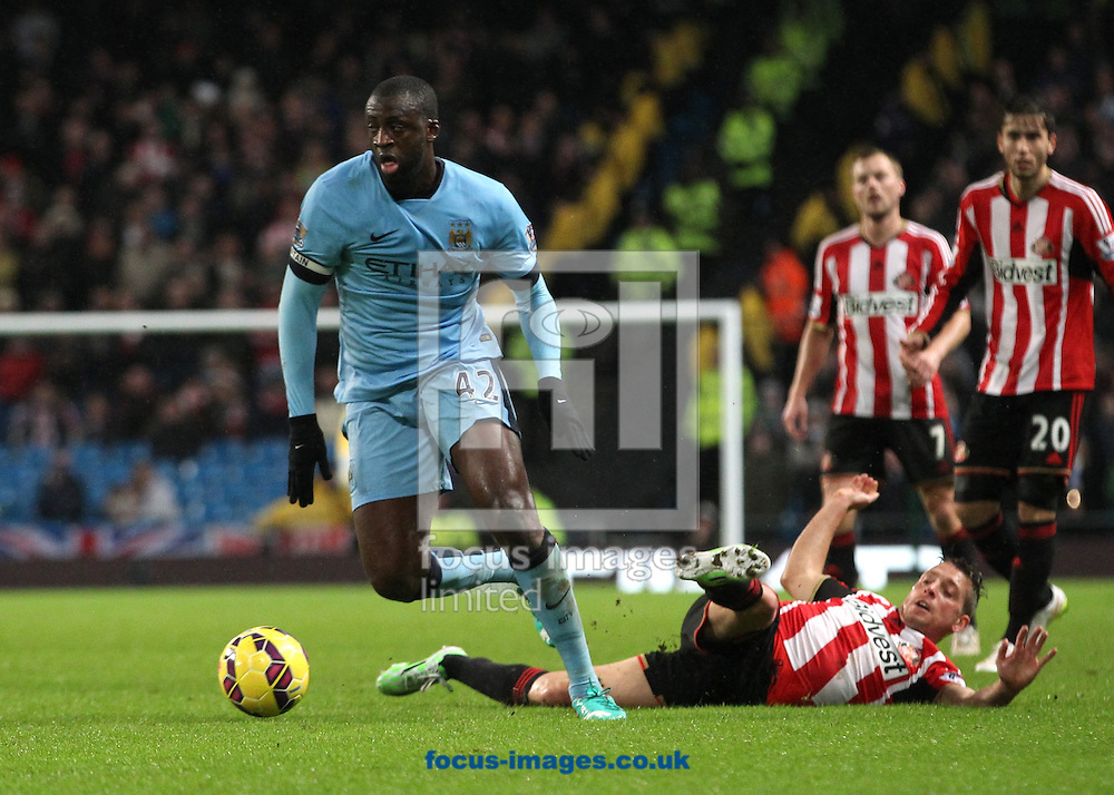 Yaya Toure of Manchester City gets past the tackle of Emanuele Giaccherini of Sunderland during the Barclays Premier League match at the Etihad Stadium, Manchester.<br /> Picture by Michael Sedgwick/Focus Images Ltd +44 7900 363072<br /> 01/01/2015