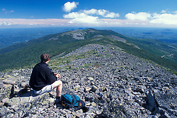 A hiker sits among the rocks on Mt. Abraham, near the Appalachian Trail.Kingfield, ME