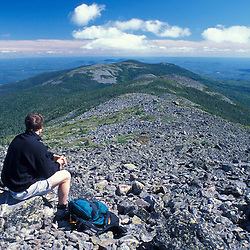 A hiker sits among the rocks on Mt. Abraham, near the Appalachian Trail.Kingfield, ME
