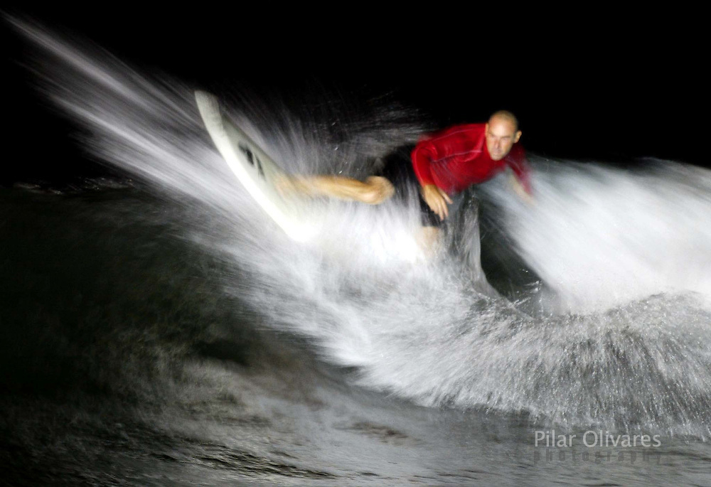 Peruvian surfer Magoo de La Rosa performs during a Latin American.championship at night at San Bartolo beach in Lima, February 8, 2003..Dozens of surfers went to the sea searching the perfect waves..REUTERS/Pilar Olivares..PO