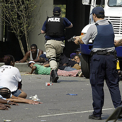 New Orleans Police hold at gunpoint looters stealing water along with the water truck on Tulane Ave. during the aftermath of Hurricane Katrina Saturday, September 3, 2005 in New Orleans, Louisiana.  <br /> (Pasadena Star-News Keith Birmingham)