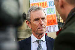 © Licensed to London News Pictures. 05/11/2019. London, UK. MP for Ribble Valley and Joint Executive Secretary of the 1922 Committee NIGEL EVANS speaks with a reporter outside Houses of Parliament in Westminster. A general election will be held on 12 December 2019.Photo credit: Dinendra Haria/LNP
