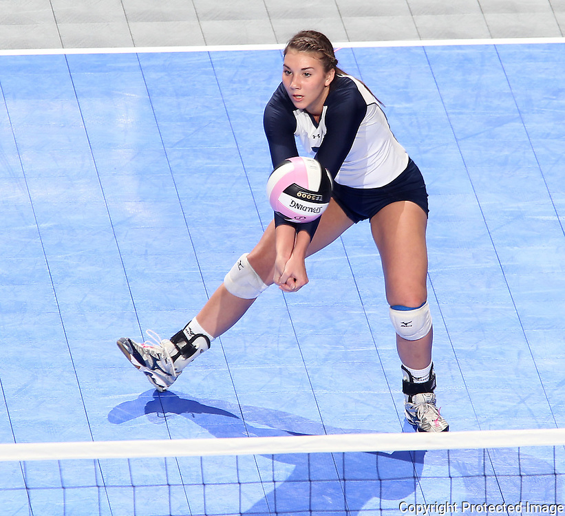 Sioux City Bishop Heelan's Kelsey McCabe (7) concentrates on the ball during the first game of a 3A semifinal in the state volleyball tournament at the U.S. Cellular Center at 370 1st Ave E on Friday afternoon, November 12, 2010. (Stephen Mally/Freelance)