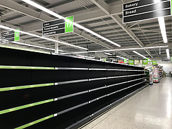 © Licensed to London News Pictures. 27/02/2018. London, UK. Empty bread shelves at Asda supermarket in Gillingham, Kent on the evening of February 26, 2018 as a cold front from Russia , named 'The Beat From The East', hits the UK. Photo credit: Graham Long/LNP
