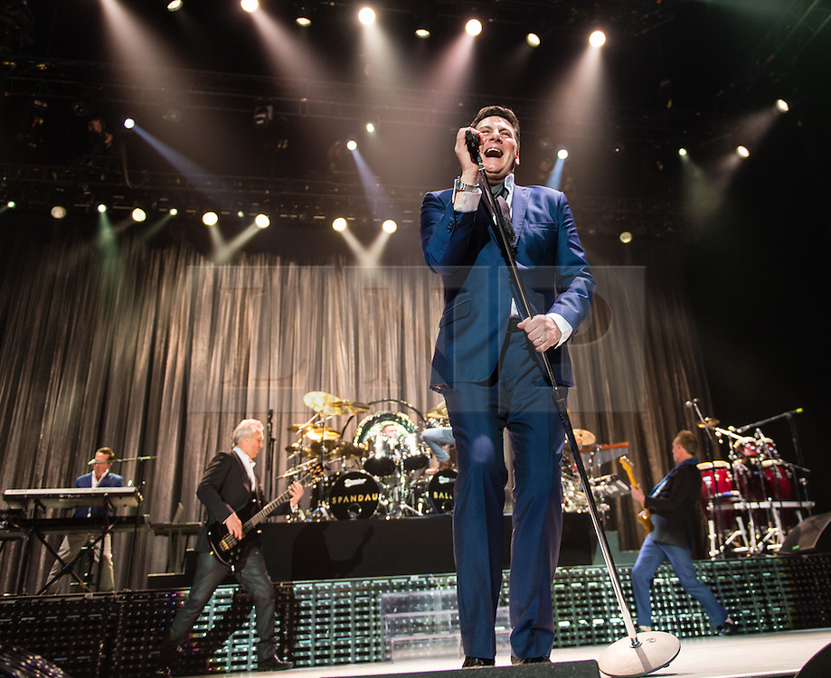 © Licensed to London News Pictures. 17/03/2015. London, UK.   Spandau Ballet performing live at The O2 Arena.   In this picture - Tony Hadley (centre), Martin Kemp (left), Gary Kemp (right). . Spandau Ballet are a British new wave band formed in London in the late 1970s, composed of members Tony Hadley (lead vocals, synthesisers), Gary Kemp ( guitar, keyboards, backing vocals), Steve Norman (saxophone, guitar, percussion), John Keeble –(drums, backing vocals), <br /> Martin Kemp (bass).  Photo credit : Richard Isaac/LNP