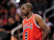 Nov. 14, 2012; Phoenix, AZ, USA; Chicago Bulls forward Luol Deng (9) reacts on the court during the game against the Phoenix Suns at the US Airways Center. The Bulls defeated the Suns 112-106 in overtime. Mandatory Credit: Jennifer Stewart-USA TODAY Sports.