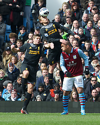 BIRMINGHAM, ENGLAND - Easter Sunday, March 31, 2013: Liverpool's Lucas Leiva and captain Steven Gerrard in action against Aston Villa's Gabriel Agbonlahor during the Premiership match at Villa Park. (Pic by David Rawcliffe/Propaganda)