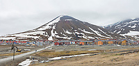 Longyearbyen, the main urban centre on the Svalbard archipelago, still showing snow patches at the height of summer at 78 degrees latitude.  Longyearbyen, Norway.