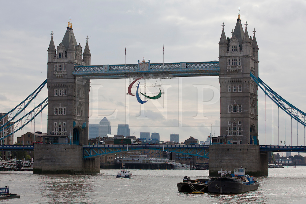 © under license to London News Pictures. 25/06/12.. The Paralympic Agitos symbol is erected on Tower Bridge...ALEX CHRISTOFIDES/LNP