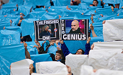 """MANCHESTER, ENGLAND - Saturday, April 7, 2018: Manchester City supporters with banners mocking Manchester United's manager Jose Mourinho """"The Finished One"""" and celebrating their own manager Pep Guardiola as a genius before the FA Premier League match between Manchester City FC and Manchester United FC at the City of Manchester Stadium. (Pic by David Rawcliffe/Propaganda)"""
