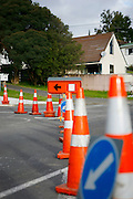 traffic cones and road signs indicate a road diversion in place at Browns Bay, Auckland, New Zealand