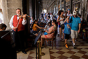Violinist plays inside the covered Procuratie Nuovo in Piazza San Marco, Venice, Italy.