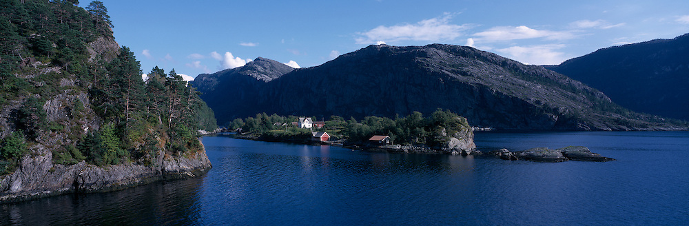Europe, Norway, Small farms nestled along a small  fjord near Måloy on Norway's west coast.