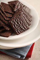 Chocolate cookies on white plate