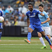 John Obi Mikel, Chelsea, in action during the Manchester City V Chelsea friendly exhibition match at Yankee Stadium, The Bronx, New York. Manchester City won the match 5-3. New York. USA. 25th May 2012. Photo Tim Clayton