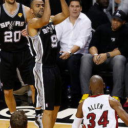 Jun 6, 2013; Miami, FL, USA; San Antonio Spurs point guard Tony Parker (9) shoots over Miami Heat shooting guard Ray Allen (34) in the second quarter during game one of the 2013 NBA Finals at the American Airlines Arena. Mandatory Credit: Derick E. Hingle-USA TODAY Sports