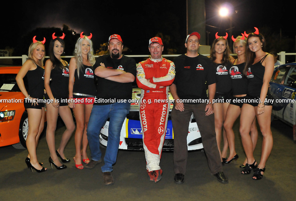 Neal Bates with Red Devil Energy staff.Offical Start.Red Devil Energy Drink Rally of Queensland.Nambour Show Grounds, Nambour, Sunshine Coast, QLD.8th of May 2009.(C) Joel Strickland Photographics.Use information: This image is intended for Editorial use only (e.g. news or commentary, print or electronic). Any commercial or promotional use requires additional clearance.