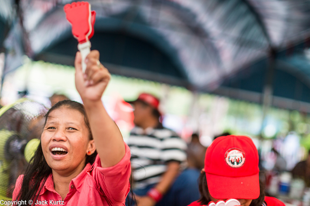 01 MAY 2013 - BANGKOK, THAILAND:   Thai Red Shirts cheer during the Red Shirt rally and protest at the Constitutional Court in Bangkok. Several hundred Thai Red Shirts, members of the United Front for Democracy against Dictatorship (UDD), have been camped out at Thailand's Constitutional Court, which oversees matters related to the Thai constitution and constitutional amendment. The Red Shirts are protesting the court's decision to consider a petition regarding the constitutionality of the constitutional amendments that have been proposed by the government. The group is arguing that by considering the petition, the Court is impeding the powers of the legislative branch. PHOTO BY JACK KURTZ