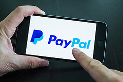 Logo of online banking app Paypal on screen of iPhone 6 plus smart phone