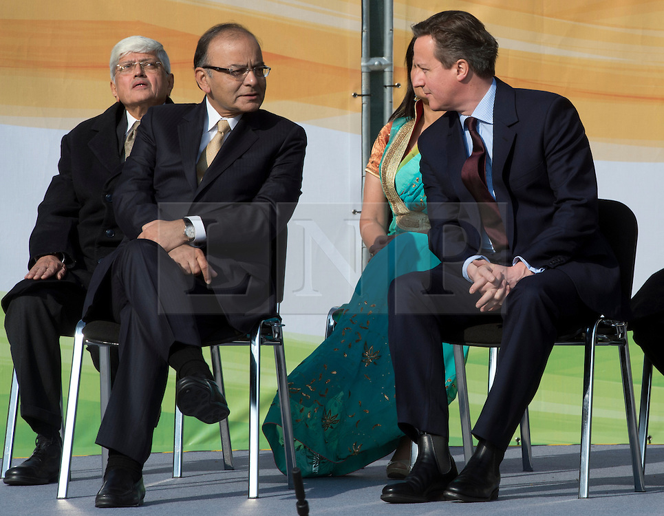 © Licensed to London News Pictures. 14/03/2015. <br /> LONDON, UK. British Prime Minister, David Cameron talks to the Indian finance minister Arun Jaitley at the unveiling of a 9ft-high bronze statue of civil rights leader, Mahatma Gandhi in Parliament Square, central London today. Photo credit: Hannah McKay/LNP