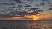 Sun rising under the Sunshine Skyway Bridge from Fort De Soto Park in Pinellas County, Florida Image taken with a Leica T camera and 11-23 mm wide-angle zoom lens (ISO 3200, 23 mm, f/16, 1/2000 sec)