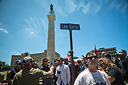 "A group of people gathered at Lee Circle in the morning to take a stand against the  ""Antifa"" and show support for keeping New Orleans Confederate monuments in tact. White suprmists also turned out to counter protest against Take 'Em Down NOLA, a group celebrating the removal of the confederate monuenets. Four Confederate monumnets were approved to be removed. So far only one has been."