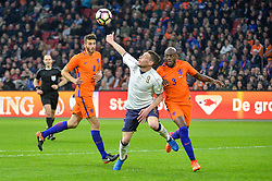 March 28, 2017 - Amsterdam, Netherlands - Andrea Belotti from Italy is challenged for the ball by Bruno Martins Indi from the Netherlands during the friendly match between Netherlands and Italy on March 28, 2017 at the Amsterdam ArenA in Amsterdam, Netherlands. (Credit Image: © Andy Astfalck/NurPhoto via ZUMA Press)