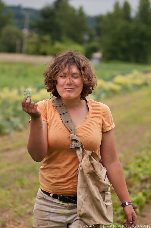 Female farm worker enjoying a bite.