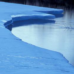 A blue ice shelf in shadows on New Hampshire's Ammonoosuc River.  White Mountains. Carroll, NH