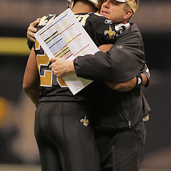 2008 November, 24: Saints head coach Sean Payton hugs Saints running back Deuce McAllister (26) after he scored a touchdown during 51-29 victory by the New Orleans Saints over the Green Bay Packers on Monday Night Football at the Louisiana Superdome in New Orleans, LA.