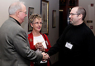 (from left) John Spain, Elaine Middlestetter of Concept Company and David Estrati of The Next Wave during the holiday meeting of the American Advertising Federation at the NCR Country Club in Kettering, Thursday, December 15, 2011.