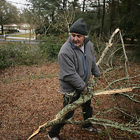 Andy Agnew removes debris at his home on Ashley Circle  in Wilmington, N.C. Thursday February 13, 2014. The area saw two days of freezing rain that caused a loss of power for much of New Hanover, Pender, and Brunswick counties.   (Jason A. Frizzelle)