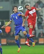 Poland, Krakow - June 04 .<br />Poland vs Lichtenstein International Friendly match at Cracovia Stadium on June 2, 2013 in Krakow.<br />Ivan Quintans of Lichtenstein and Maciej Rybus<br />Photo by: Piotr Hawalej