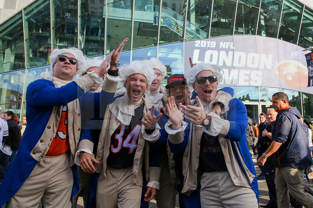 © Licensed to London News Pictures. 06/10/2019. London, UK. American Football fans dressed as Benjamin Franklin (Founding Father of the United States) arrive for the NFL (The National Football League) London Games when Oakland Raiders faces Chicago Bears in the first of the two games to be played at the new Tottenham Hotspur Stadium. Photo credit: Dinendra Haria/LNP