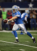Detroit Lions quarterback Matthew Stafford (9) hands off the ball on a running play during the NFL week 18 NFC Wild Card postseason football game against the Dallas Cowboys on Sunday, Jan. 4, 2015 in Arlington, Texas. The Cowboys won the game 24-20. ©Paul Anthony Spinelli