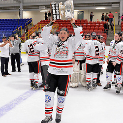 FORT FRANCES, ON - May 2, 2015 : Central Canadian Junior &quot;A&quot; Championship, game action between the Fort Frances Lakers and the Soo Thunderbirds, Championship game of the Dudley Hewitt Cup. Owen Headrick #27 of the Soo Thunderbirds raises the Dudley Hewitt Cup.<br /> (Photo by Shawn Muir / OJHL Images)