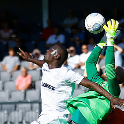 Dovers forward Ntumba Massanka makes life difficult for Barnets keeper Mark Cousins during the National League match between Dover Athletic and Barnet FC at Crabble Stadium, Kent on 1 September 2018. Photo by Matt Bristow.
