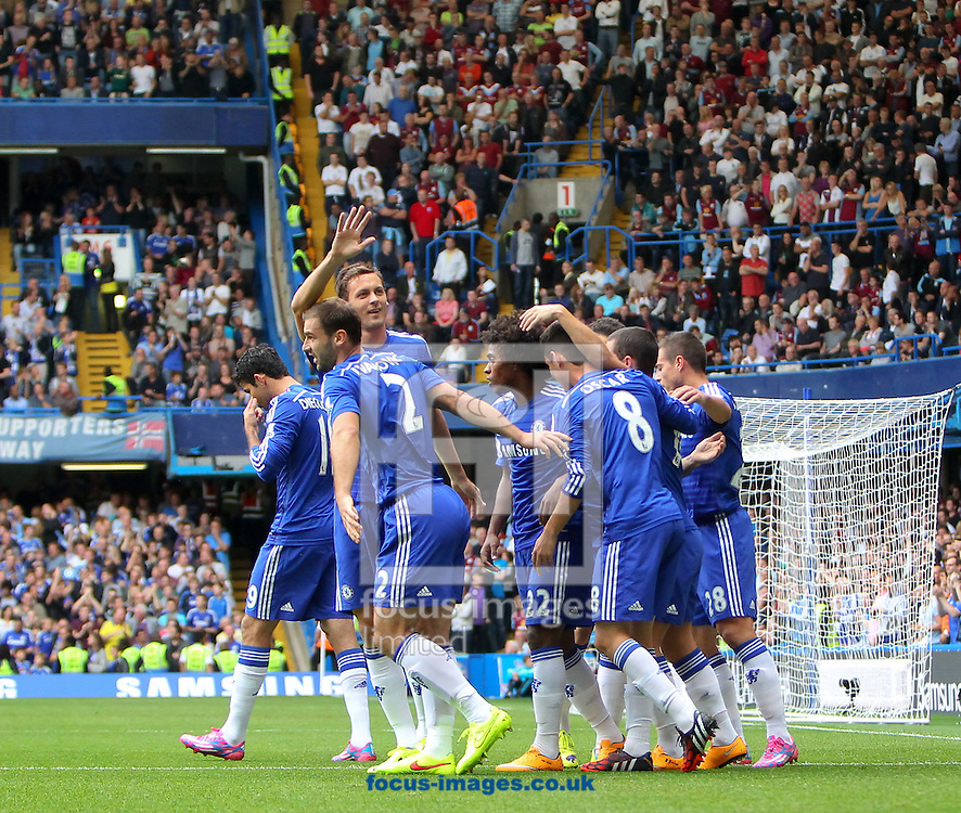 Oscar of Chelsea is congratulated by team-mates after opening the scoring against Aston Villa during the Barclays Premier League match at Stamford Bridge, London<br /> Picture by John Rainford/Focus Images Ltd +44 7506 538356<br /> 27/09/2014