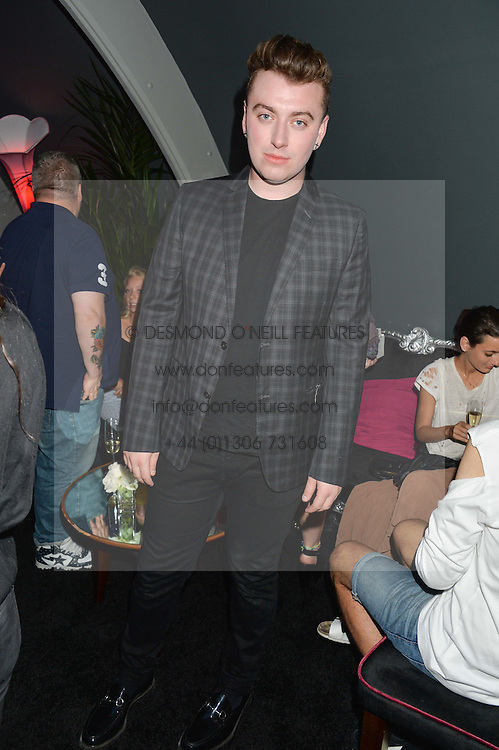 Singer SAM SMITH at a Bastille Day Cocktail Party at L'Escargot, 48 Greek Street, London on 14th July 2014.