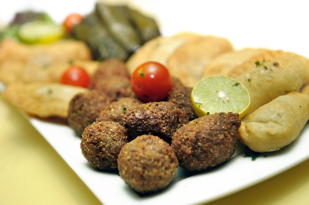 "Typical Egyptian ""Mezze"" in the ""Nile Maxim"" boat, Cairo, Egypt. A meze or mezze, in eastern Mediterranean, is a selection of appetizers or small dishes similar to tapas of Spain or finger food. In other Levantine cuisines, these dishes form part of any large-scale meal, but are known as muqabbilat (starters) when not accompanied with alcohol."