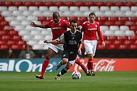 Photo: Pete Lorence.<br />Nottingham Forest v Swansea City. Coca Cola League 1. 30/09/2006.<br />Swansea's Leon Britton dodges around Junior Agogo.