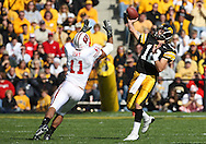 18 OCTOBER 2008: Iowa quarterback Ricky Stanzi (12) throws a pass over Wisconsin linebacker DeAndre Levy (11) in the first half of an NCAA college football game against Wisconsin, at Kinnick Stadium in Iowa City, Iowa on Saturday Oct. 18, 2008. Iowa won 38-16.